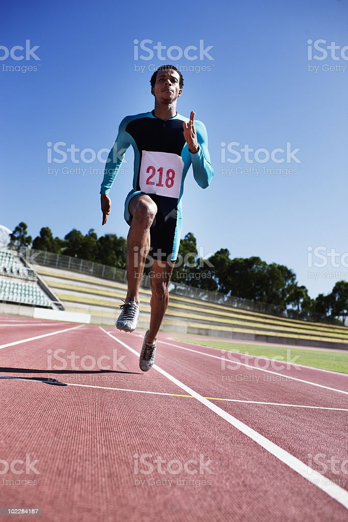 Runner sprinting on track royalty-free stock photo