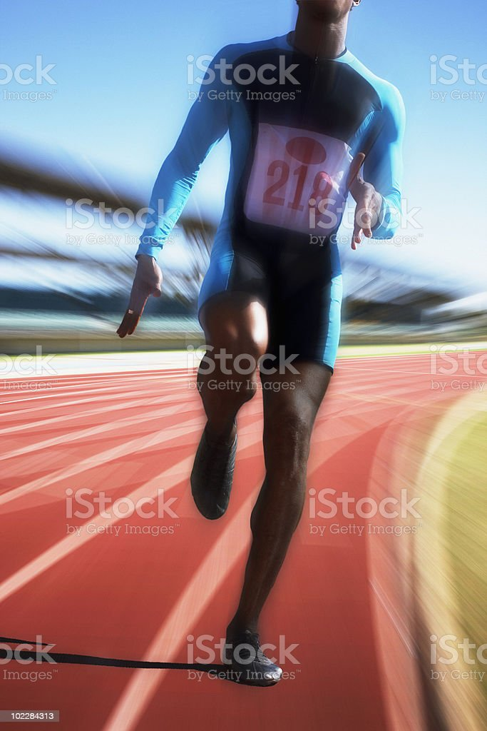 Runner sprinting on track stock photo