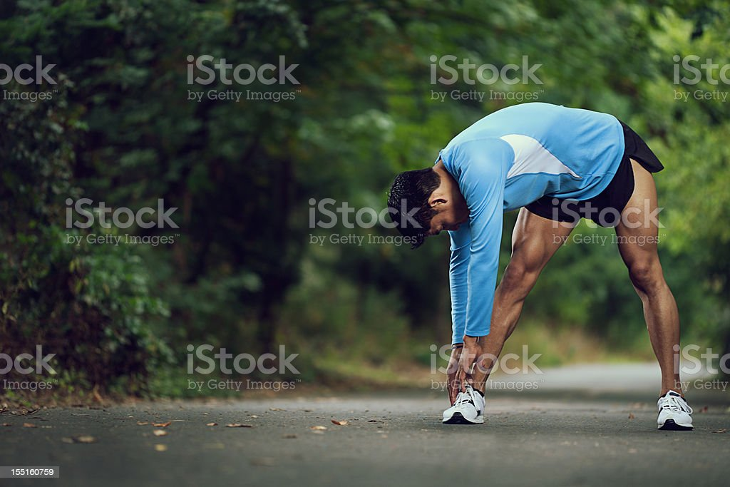 Runner stopping for a stretch royalty-free stock photo