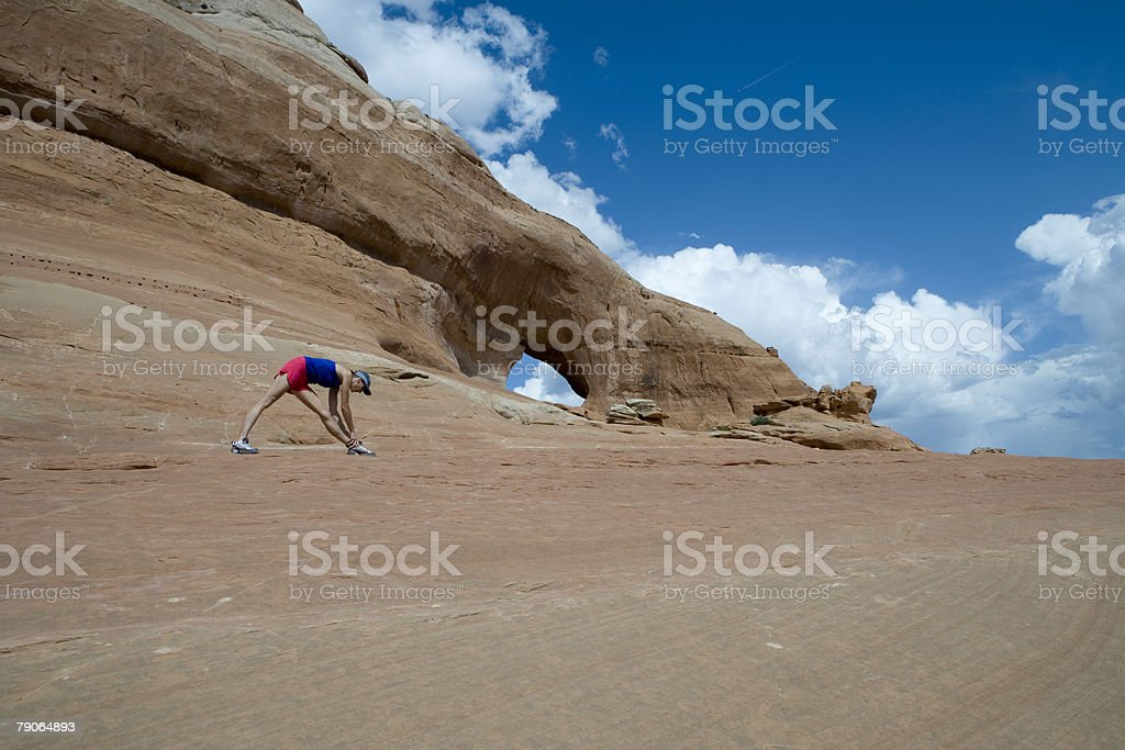 Runner stretching by looking glass rock stock photo