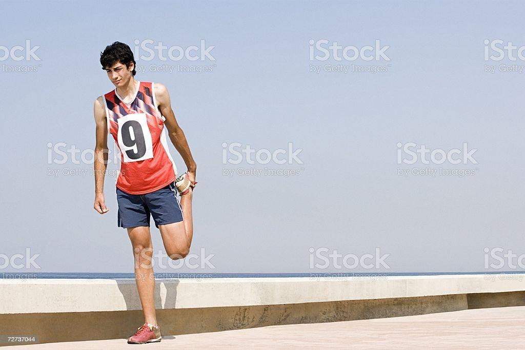 Runner stretching his leg royalty-free stock photo