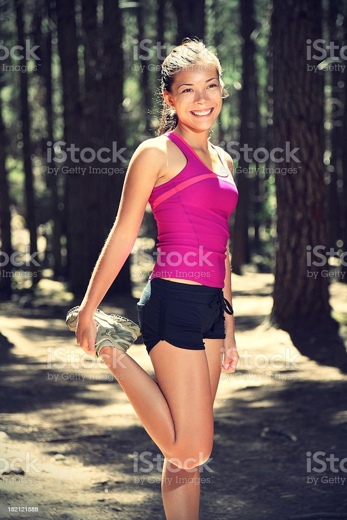 Runner stretching out during workout royalty-free stock photo