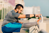 Runner Stretching Outdoors.