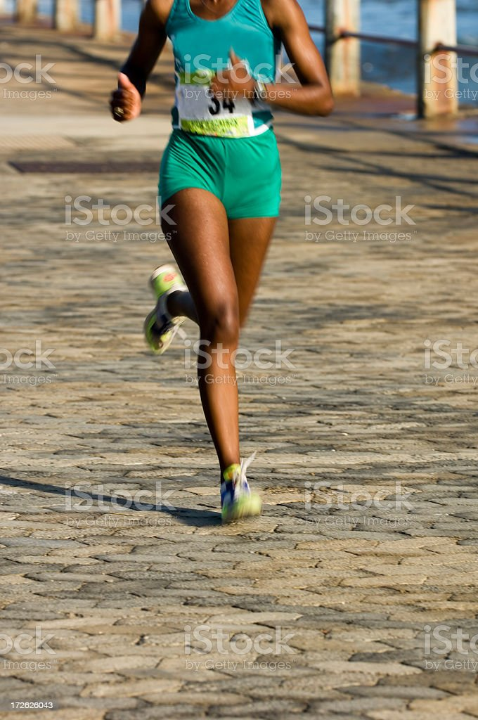 Runner striding out royalty-free stock photo