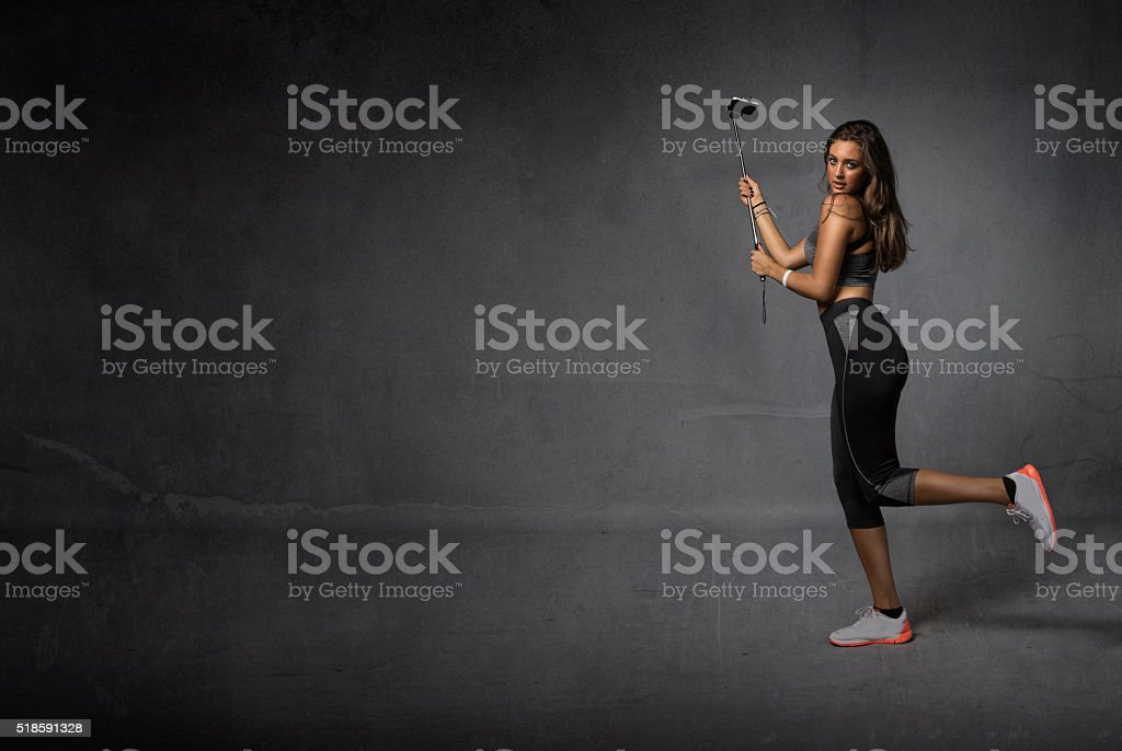 runner taking a selfie with selfie stick stock photo