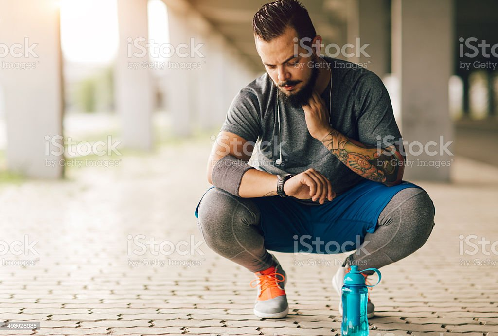 Runner Taking Pulse. stock photo