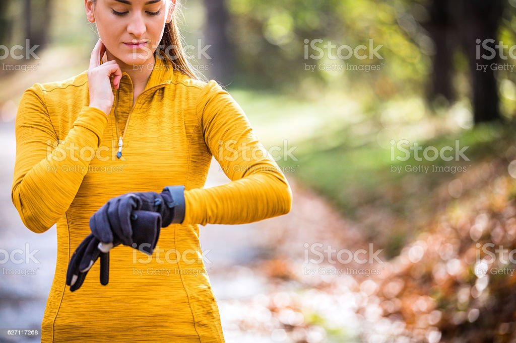 Runner taking pulse stock photo