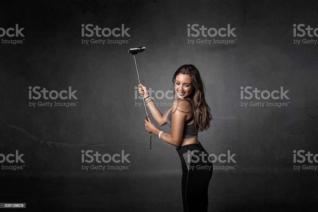 runner taking selfie stock photo