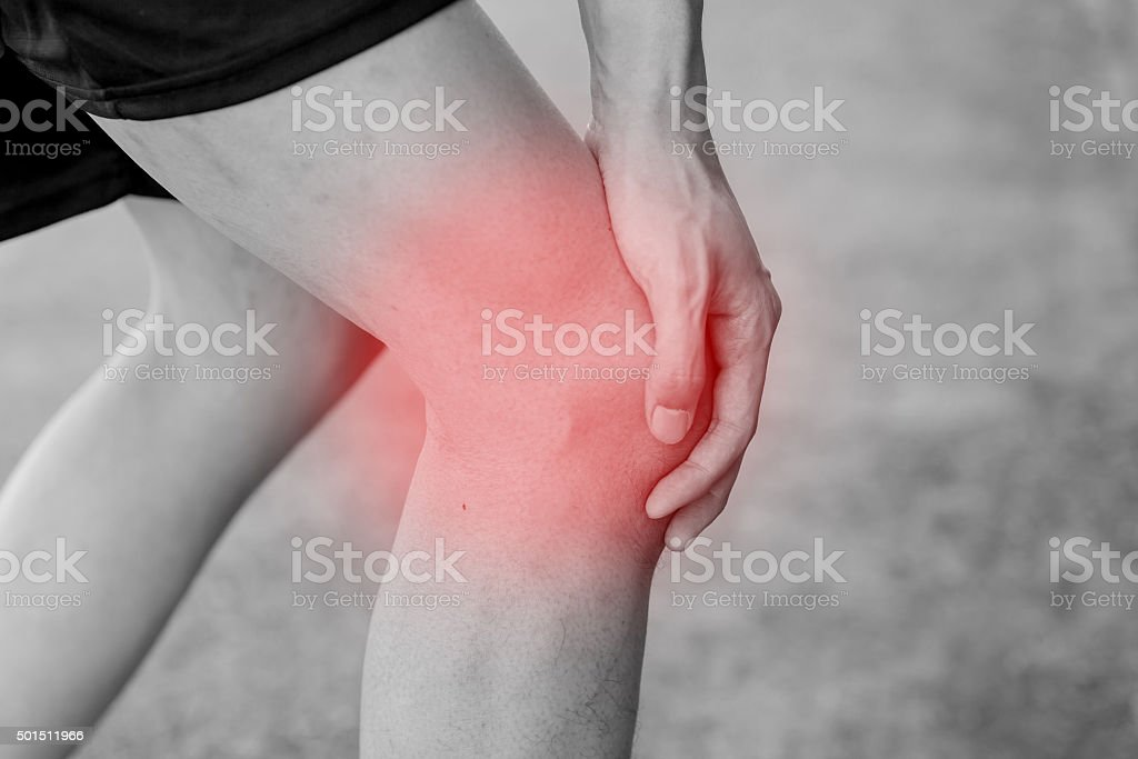Runner touching painful knee. Athlete runner training accident. stock photo