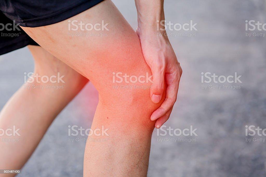 Runner touching painful knee. Athlete runner training accident. stock photo