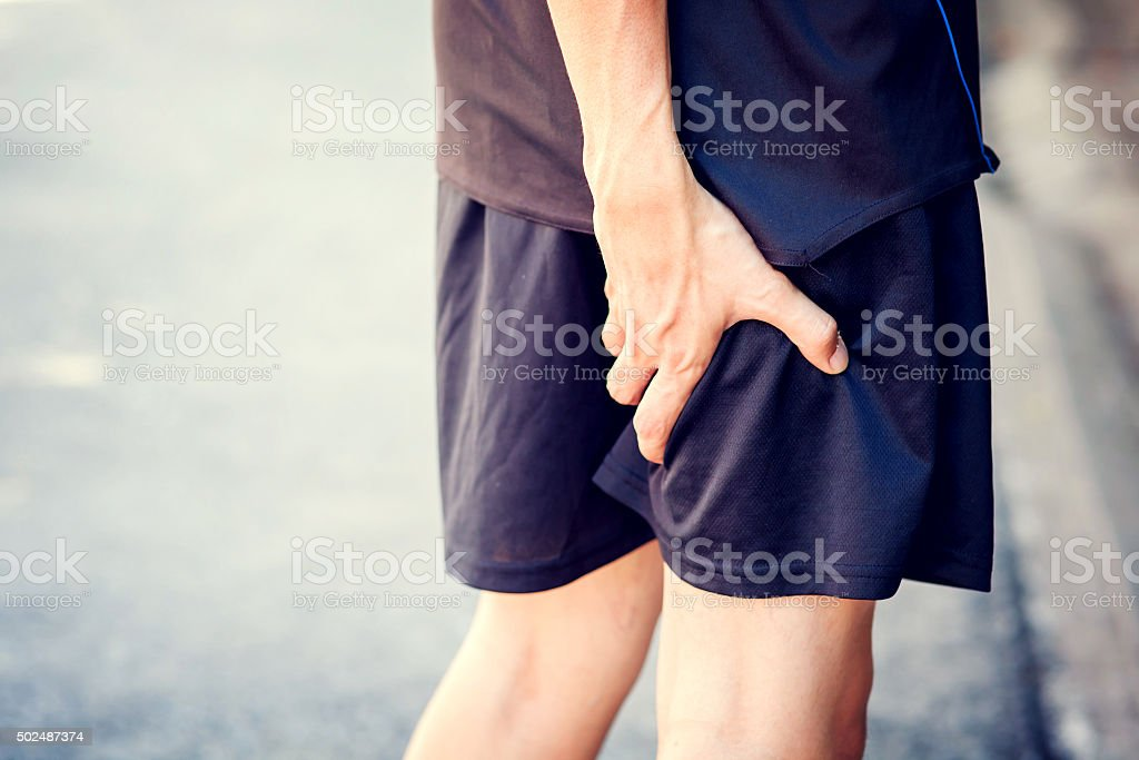 Runner touching painful leg. Athlete runner training accident. stock photo
