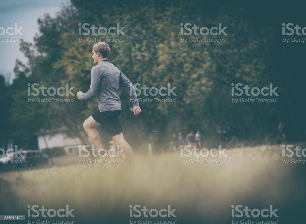 Runner Training on Dark Moody Day stock photo