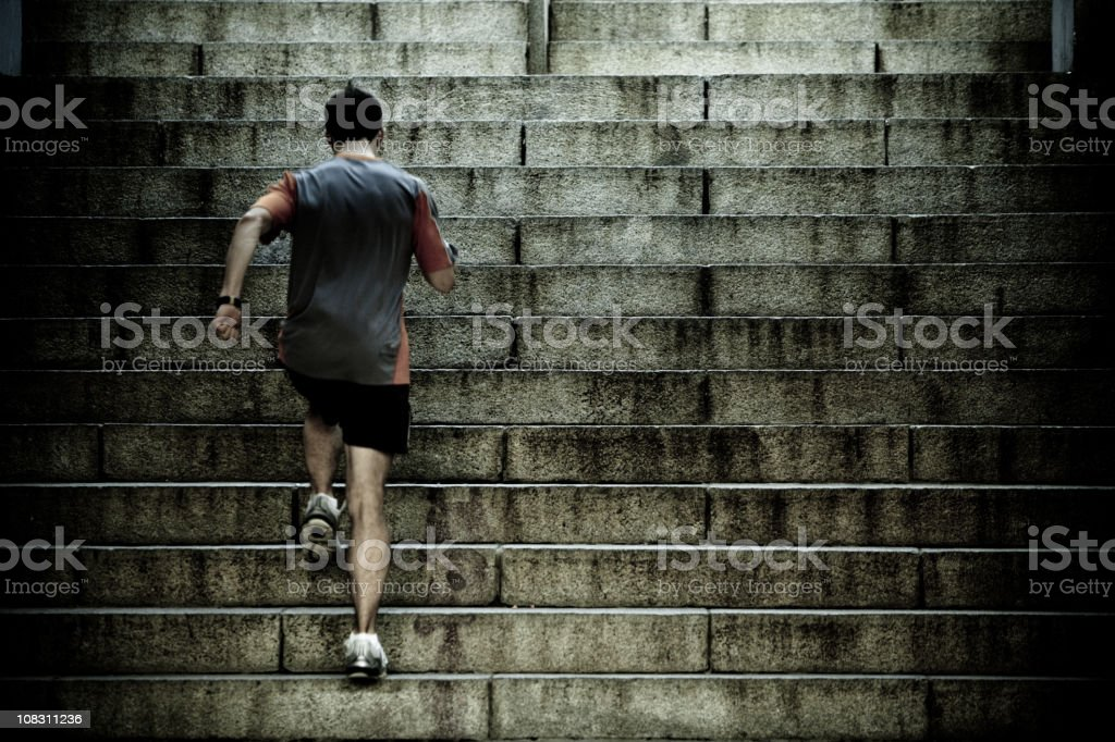 Runner training on stair intervals stock photo