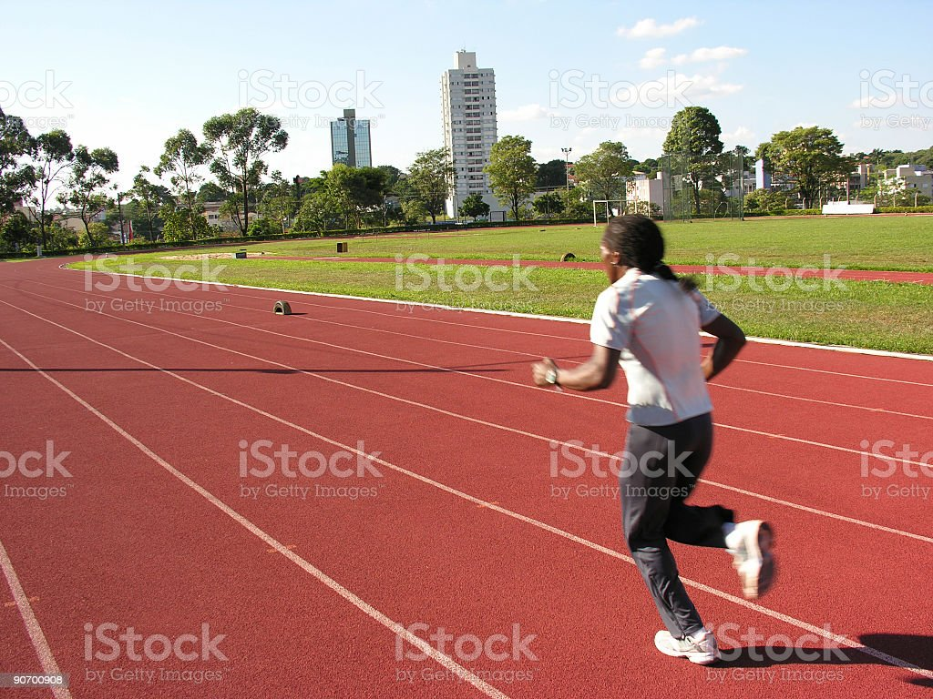 Runner trainning at a racetrack royalty-free stock photo