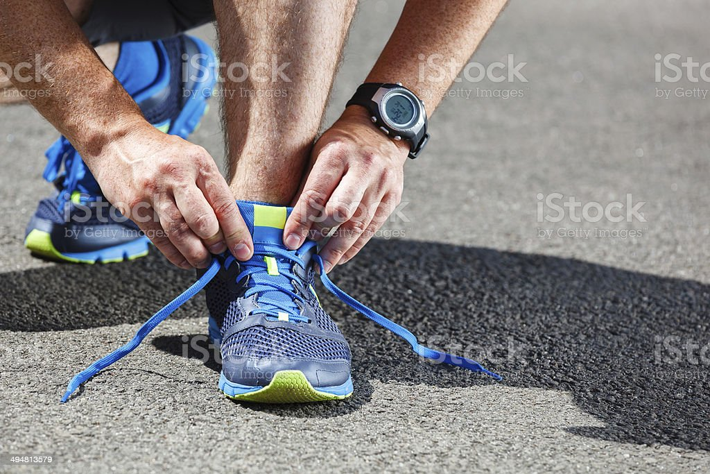 Runner trying running shoes getting ready for run. stock photo