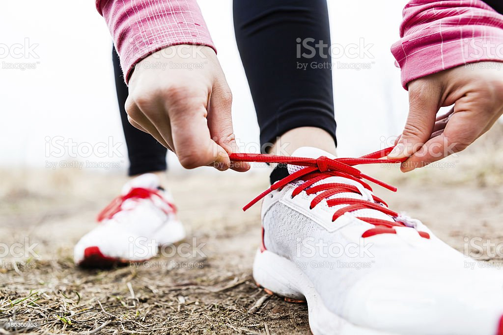 Runner tying sport shoes stock photo