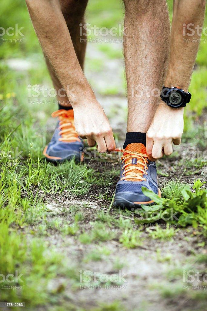 Runner tying sports shoe royalty-free stock photo