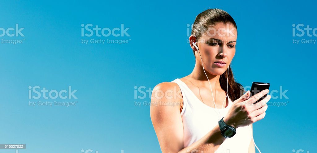 Runner use smart phone and smart watch stock photo