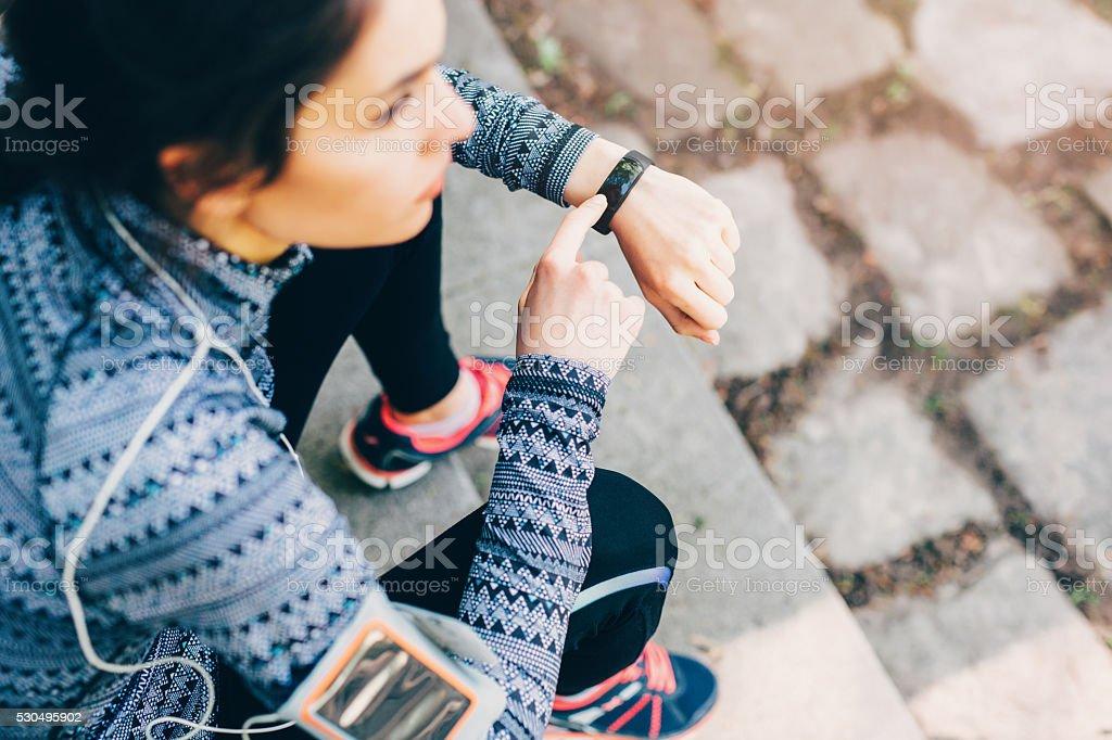 Runner using smart watch stock photo