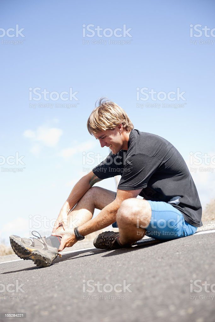 Runner with a lower leg or ankle injury royalty-free stock photo