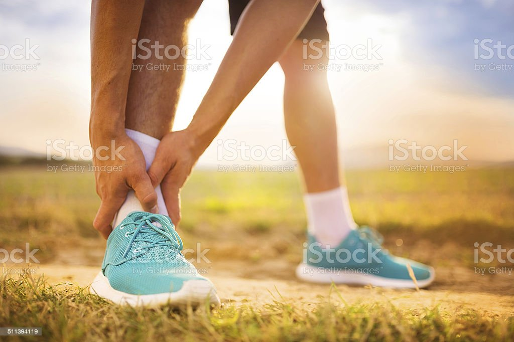 Runner with injured ankle stock photo