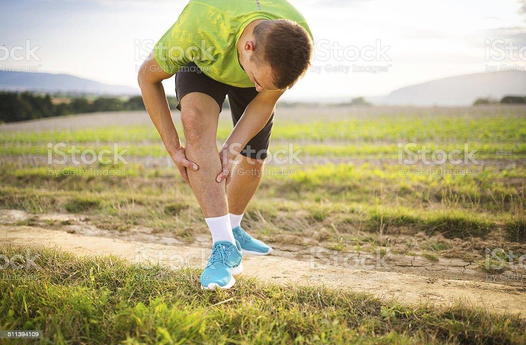 Runner with injured calf stock photo