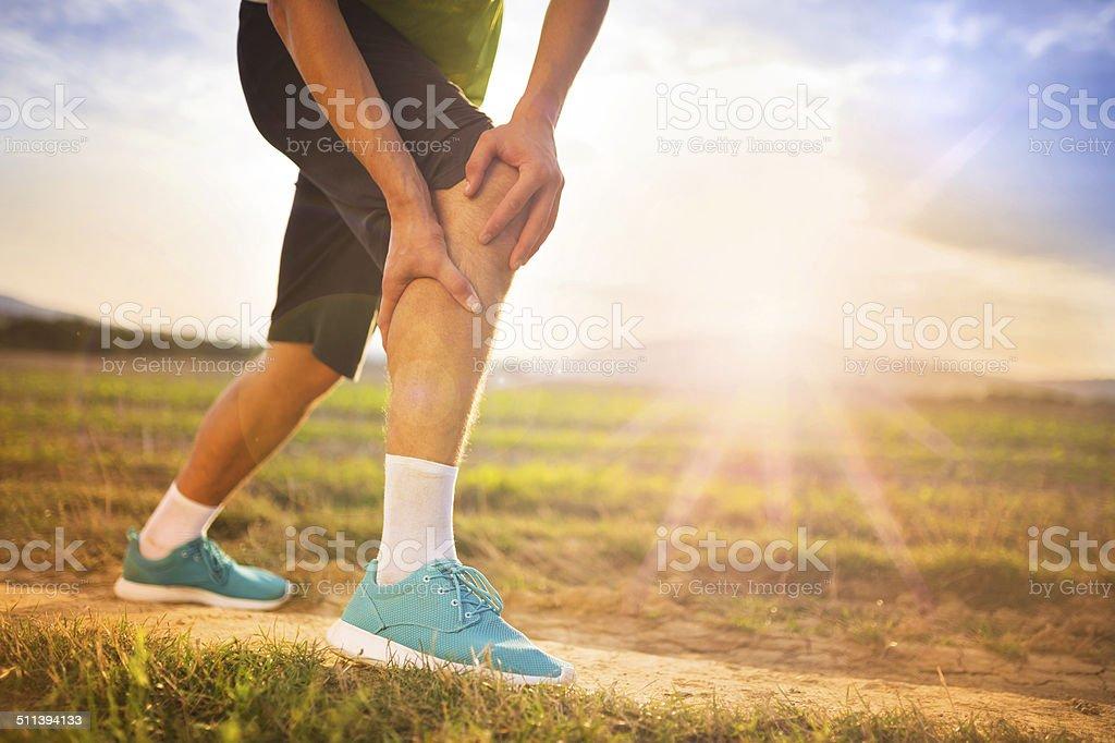 Runner with injured knee stock photo