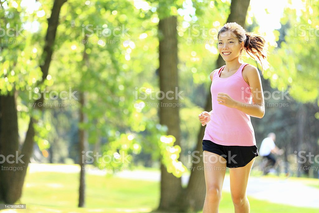 Runner - woman running in park royalty-free stock photo