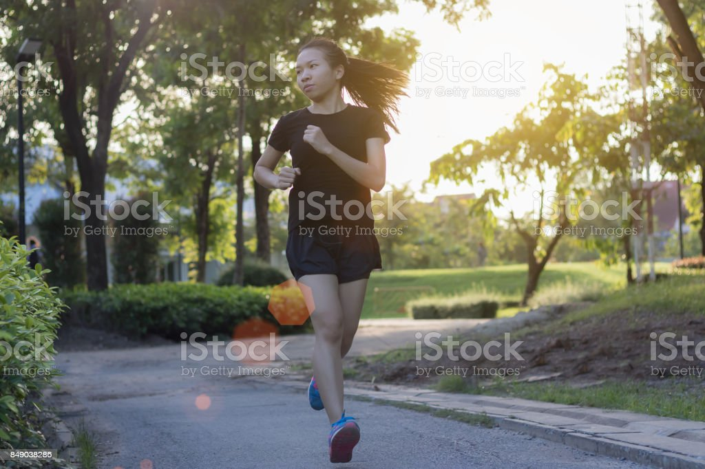 Runner woman running in the garden stock photo
