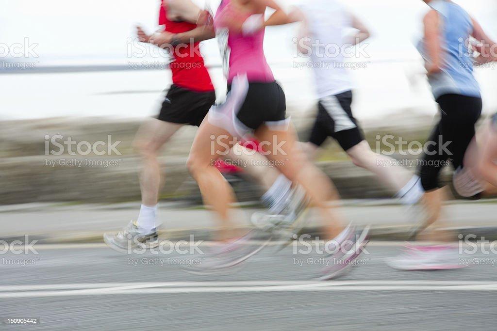 runners, blurred motion stock photo