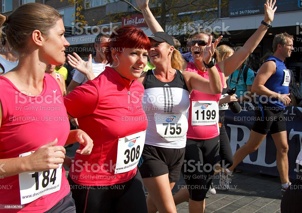 Runners celebrate the start royalty-free stock photo