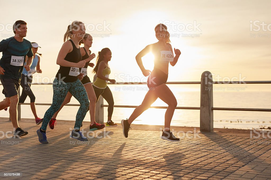 Runners competing in a marathon race stock photo