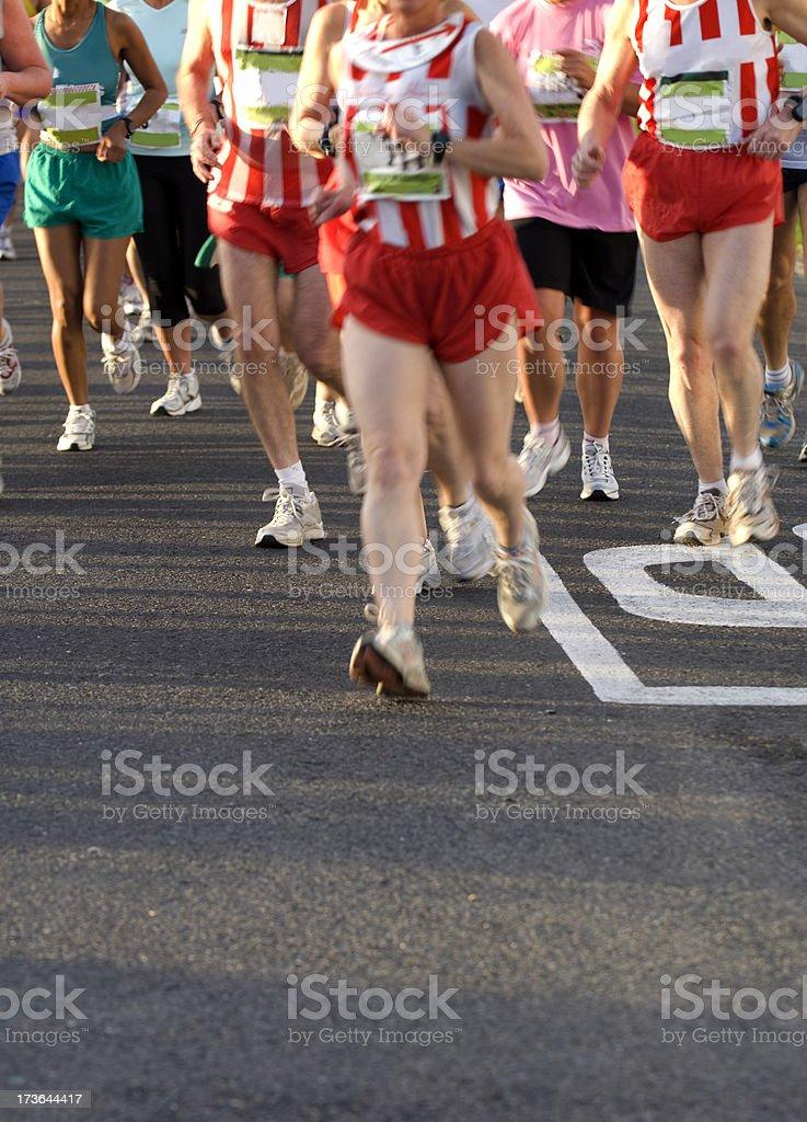Runners Cornering stock photo
