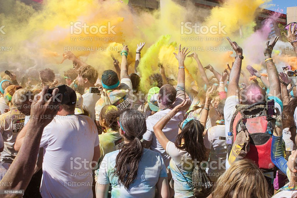 Runners Create Color Explosion With Multicolored Corn Starch Packets stock photo