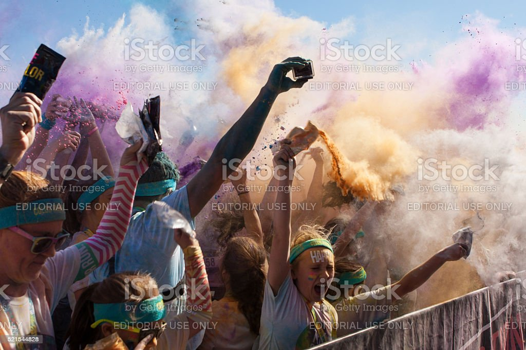 Runners Create Color Explosion With Packets Of Colored Corn Starch stock photo