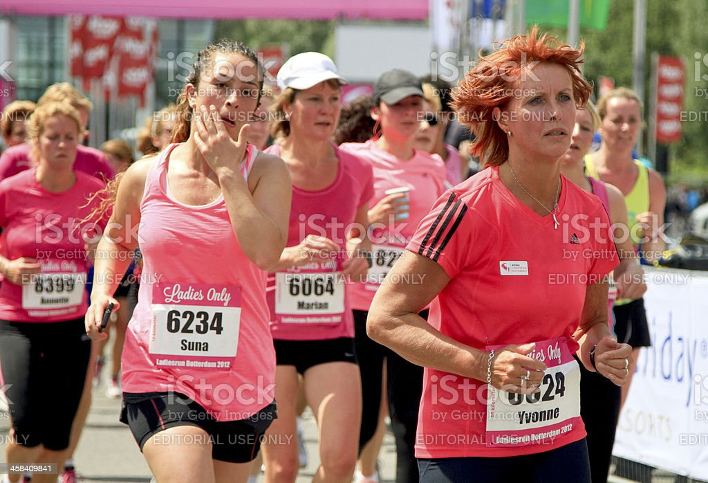 Runners dressed in pink royalty-free stock photo
