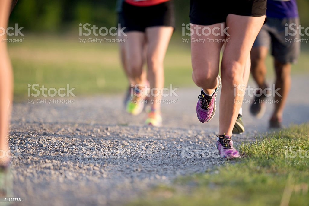 Runners Feet on a Gravel Trail stock photo