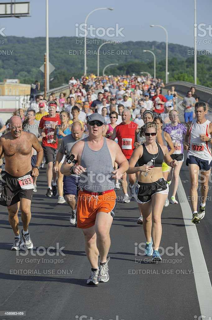 Runners in Crowded Outdoor Foot Race, Head On View royalty-free stock photo