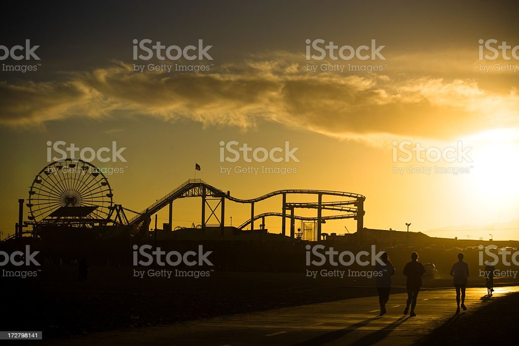 Runners in front of the Santa Monica Pier royalty-free stock photo