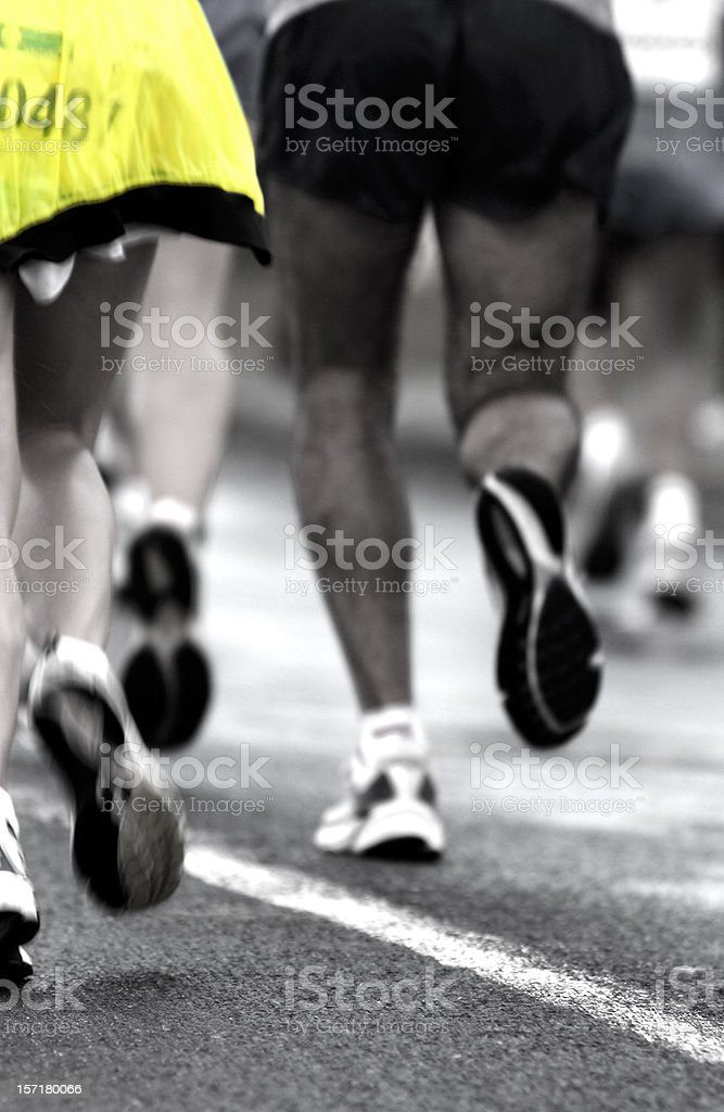 Runners in motion stock photo