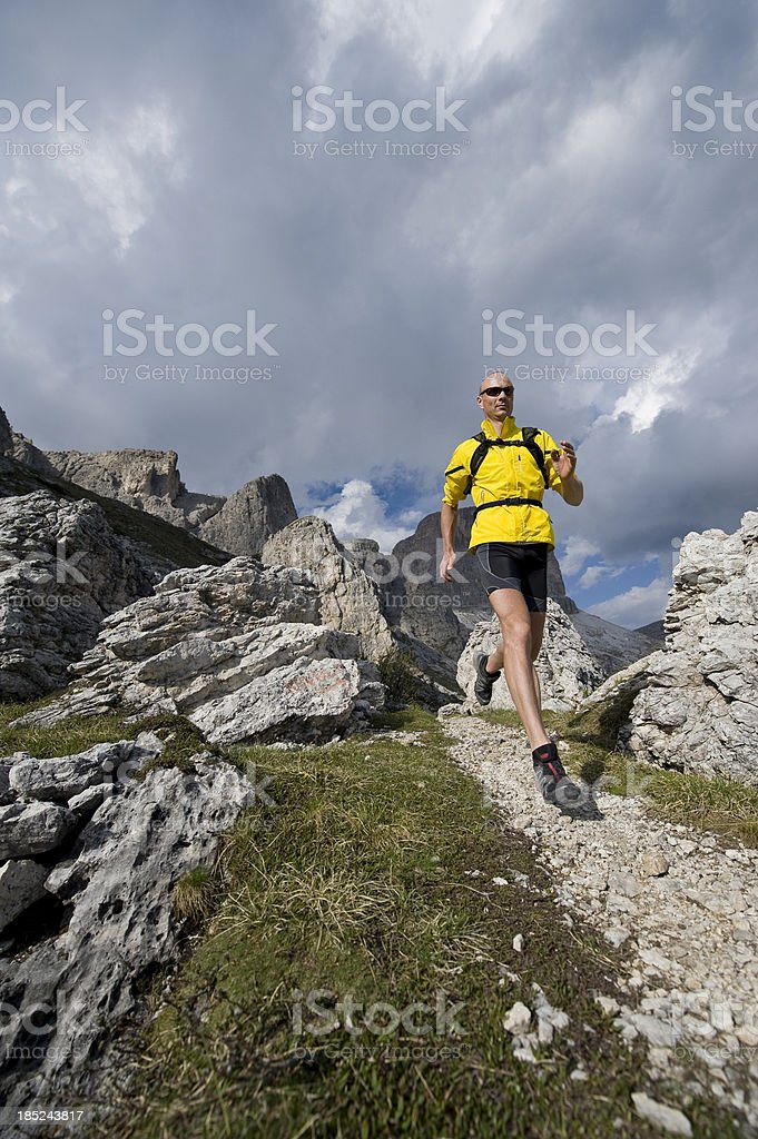 Runners in nature between rock and stone stock photo