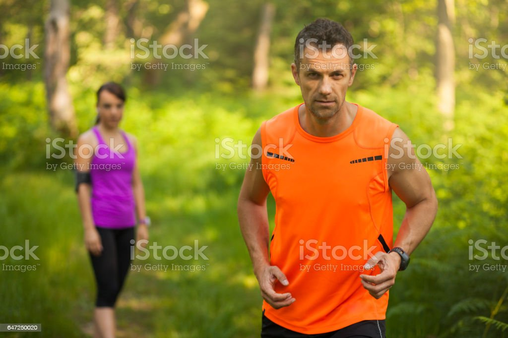 Runners in the forest stock photo