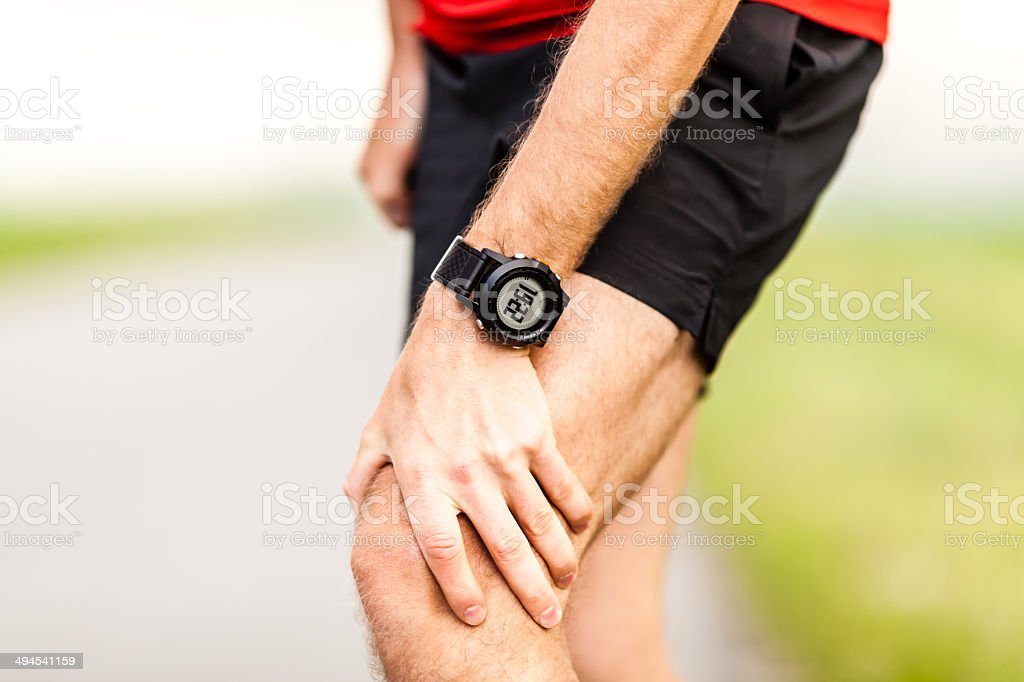Runners leg knee pain injury stock photo
