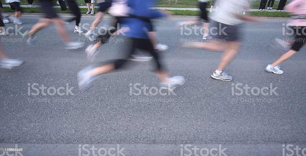 Runners Legs at a Cross Country Relay Race Start royalty-free stock photo