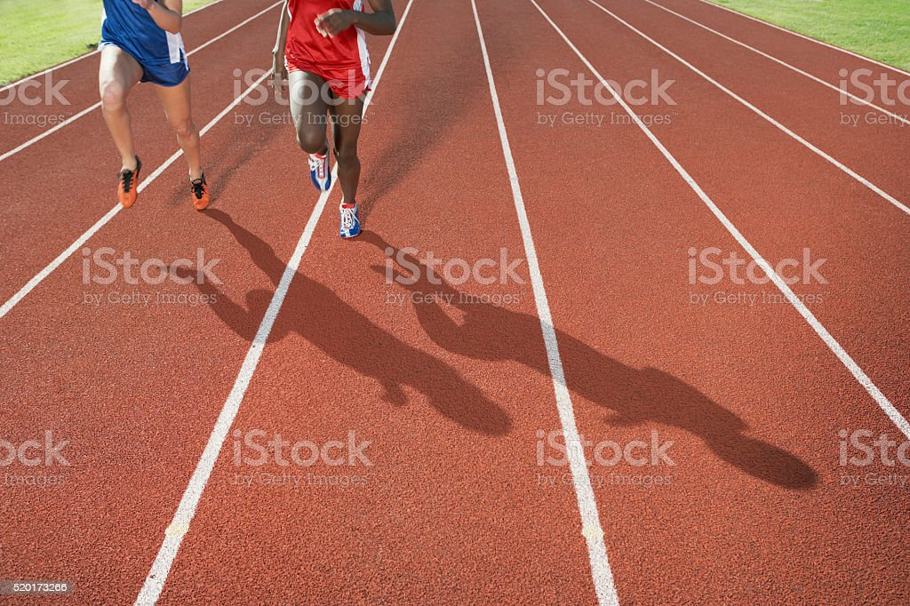 Runners on a track stock photo