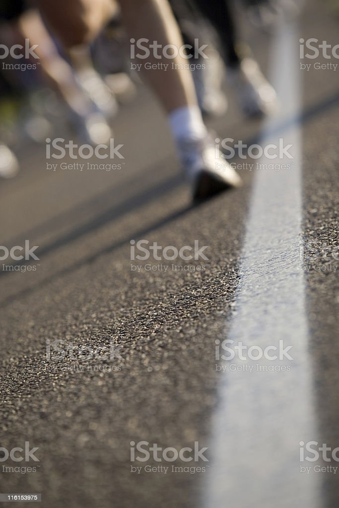 runners on an asphalt road royalty-free stock photo