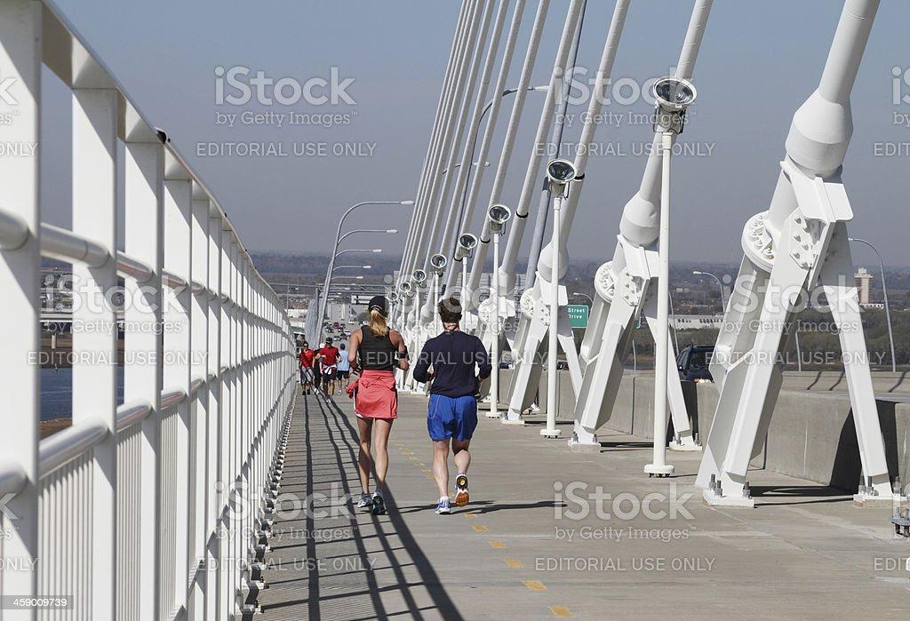 Runners on Arthur Ravenel Bridge in Charleston stock photo