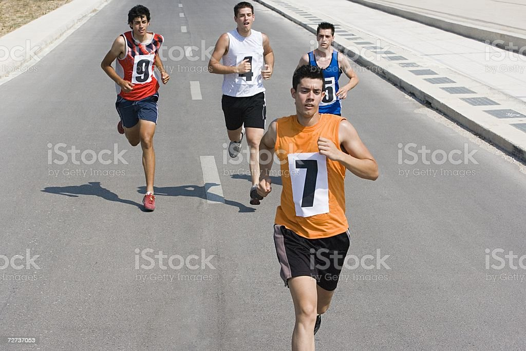 Runners on road royalty-free stock photo