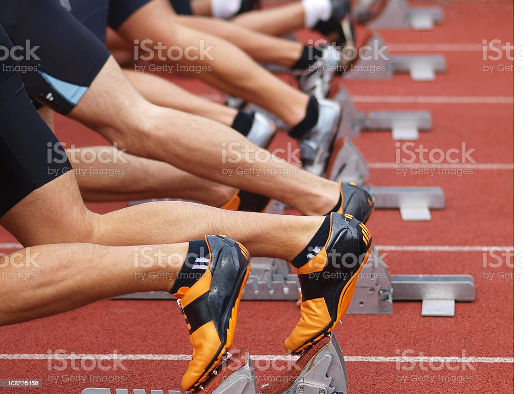 Runners on starting blocks stock photo