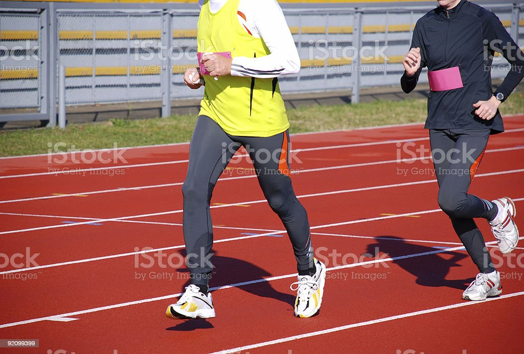 runners on the running track royalty-free stock photo